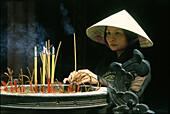 Worship in Dai Hung temple, Hue, Vietnam, Asia