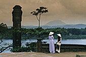 Two People in front of Perfume River, from Thiem Mu Pagoda, Hue, Vietnam