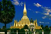 Golden That Luang stupa under blue sky, Vientiane, Laos, Asia