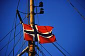 Norwegian flag on sailboat mast, Oslo, Norway Scandinavia
