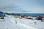 View at snow covered village on the waterfront, Ilulissat, Greenland