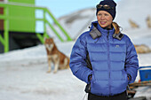 Young Woman with a dog in the background, Jakobshavn, Ilulissat, Greenland