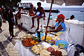 People at a cookshop at the seaside promenade, Porto da Barra, Salvador da Bahia, Brazil, South America, America