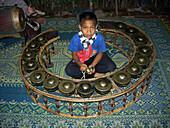 Boy musician, Luang Prabang, Laos Indochina, Asia