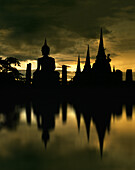 Temple and Buddha statue reflecting on the river in the evening, Wat Phra Si Sanphet, Ayuthaya, Thailand, Asia