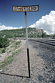 Sign and tracks under blue sky, Copper canyon, Divisadero, Chihuahua, Mexico, America