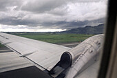 View out of the window of an airplane during the take off, Fiji, South Pacific