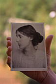 Hand holfing postcard of Virginia Woolf, England, UK