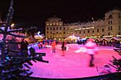 Winter attraction, ice rink at Karlsplatz, Stachus, Munich, Bavaria, Germany