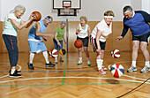 Mature People playing basketball