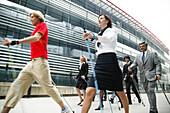 Business People doing Nordic Walking
