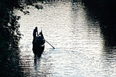 Lonely gondolier rowing on Elster river, Leipzig, Saxony, Germany