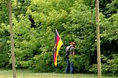 German soccer fan with flag, Leipzig, Saxony, Germany