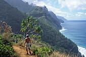 Hiking along Kauai Coastline, Kalalau Trail, Na Pali Coast, Kauai, Hawaii, USA