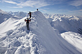 Three skier on ridge, way to extreme ski run, Nebelhorn, Oberstdorf, Bavaria, Germany