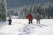 Family with one boy snowshoeing in fresh powder snow, Ellmau, Garmisch-Partenkirchen, Germany