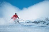 Woman telemark skiing in fresh powder snow, front view, Zugspitze, Garmisch-Partenkirchen, Germany