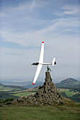 Glider Airplane behind Aviator Monument, Wasserkuppe Mountain, Rhoen, Hesse, Germany