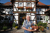 Man with Traditional German Sausages, Haunetal Oberstoppel, Hesse, Germany