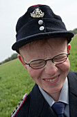 Young Firefighter with Quirky Smile, Simmershausen Festival, Hilders-Simmershausen, Rhoen, Hesse, Germany