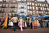 Couple, Market Stand, Albert Cuypstraat Market, Couple sauntering along market stalls at Albert Cuypstraat Market, Amsterdam, Holland, Netherlands