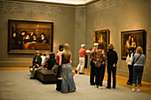 Visitors, Paintings, Rijksmuseum, Visitors looking at serveral paintings at Rijksmuseum, Amsterdam, Holland, Netherlands