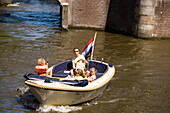 Family, Leisure Boat, Keizersgracht , Family having a trip with a leisure boat on Keizersgracht, Amsterdam, Holland, Netherlands