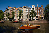 Leisure Boats, Amsterdam Houses, Keizersgracht, Leisure boats on Keizersgracht passing typical gabled houses, Amsterdam, Holland, Netherlands
