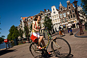 Cyclist, Keizersgracht, Woman cycling along Keizersgracht, blurred, Amsterdam, Holland, Netherlands