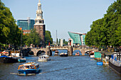 Montelbaanstoren, Watch Tower, NEMO Museum, Oude Schans, View over Oude Schans with leisure boats to Montelbaanstoren watch tower, and NEMO Museum, Amsterdam, Holland, Netherlands