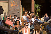 Guests, Waitress, Cafe Cuba, Nieuwmarkt, Waitress serving drinks in open air cafe, Cafe Cuba, Nieuwmarkt new market, , Amsterdam, Holland, Netherlands