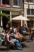Guests, Cafe Finch, Noorderkerkplein, Jordaan, Young people sitting in open air Cafe Finch, Noorderkerkplein, Jordaan, Amsterdam, Holland, Netherlands