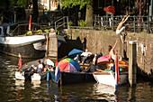 Leisure Boats, Brouwersgracht, Jordaan, People sitting in leisure boats on a sunny day, Brouwersgracht, Jordaan, Amsterdam, Holland, Netherlands