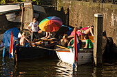 People, Leisure Boats, Brouwersgracht, Jordaan, Young People relaxing in leisure boats on a sunny day, Brouwersgracht, Jordaan, Amsterdam, Holland, Netherlands