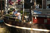 Couple, Diner, Houseboat, Prinsengracht, Jordaan, Couple having diner on a houseboat, Prinsengracht, Jordaan, Amsterdam, Holland, Netherlands