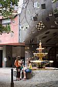 Girls in front of Hundertwasserhaus, Vienna, Austria