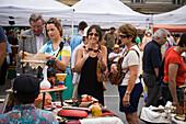 Woman dealing with seller at saturday fleamarket, Naschmarkt, Vienna, Austria