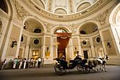 Fiaker passing Sisi Museum, Alte Hofburg, Vienna, Austria