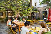People sitting in open-air area of Stomach, Alsergrund, Vienna, Austria