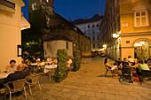People sitting in open-air restaurants, close to Ruprechtskirche, Vienna, Austria