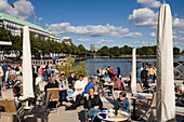 People sitting in the open-air area of the restaurant Alsterpavillon, Hamburg, Germany