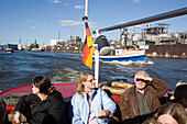 Harbour tour with a barge, People having a harbour tour with a barge at harbour, Hamburg, Germany