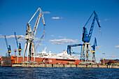 Dry-dock with cranes of the Bloom and Voss dockyard, Dry-dock with cranes of the Bloom & Voss Werft dockyard, , Landungsbruecken, Hamburg, Germany