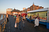 People walking over the fish market early in the morning, St. Pauli, Hamburg, Germany