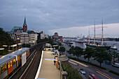 Railroad station platform Landungsbruecken and pier with sailing ship SS Rickmer Rickmers, Hamburg, Germany