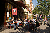 People sitting outside of Cafe Gnosa at St. Georg street, Hamburg, Germany