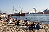 People relaxing at Elbe beach, Oevelgoenne, Hamburg, Germany