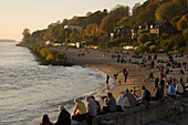 People relaxing at beach in the evening, Oevelgoenne, Hamburg, Germany