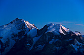 Evening glow on Piz Bernina and Piz Morteratsch, Engadin, Graubuenden, Grison, Switzerland, Alps