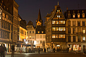 Place de la Cathedrale and Maison Kammerzell, View over the Place de la Cathedrale Cathedral Square, to one of the oldest and loveliest timbered houses the Maison Kammerzell at night, Strasbourg, Alsace, Franc